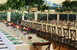 Crossback chairs, long trestle tables and Reserva glassware with ivory linen