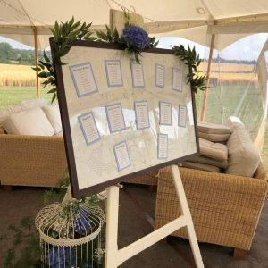 White wooden easel with table plan