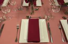 Pink table cloths and burgundy napkins