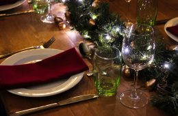 Rustic trestle with a Christmas theme, green glasses and burgundy napkins