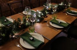 Rustic Christmas trestle table with green napkins