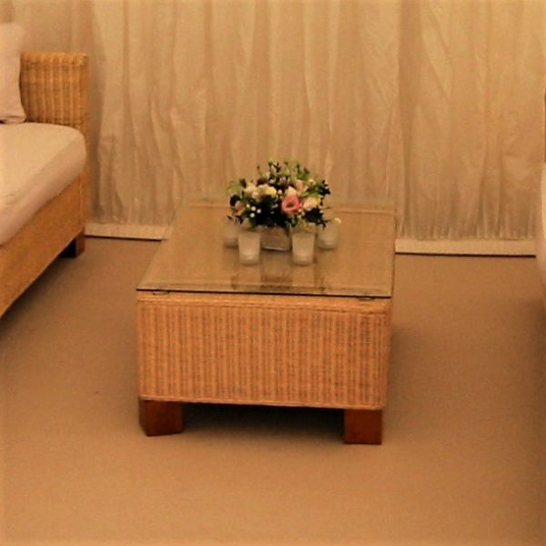 Beige rattan coffee table with glass top