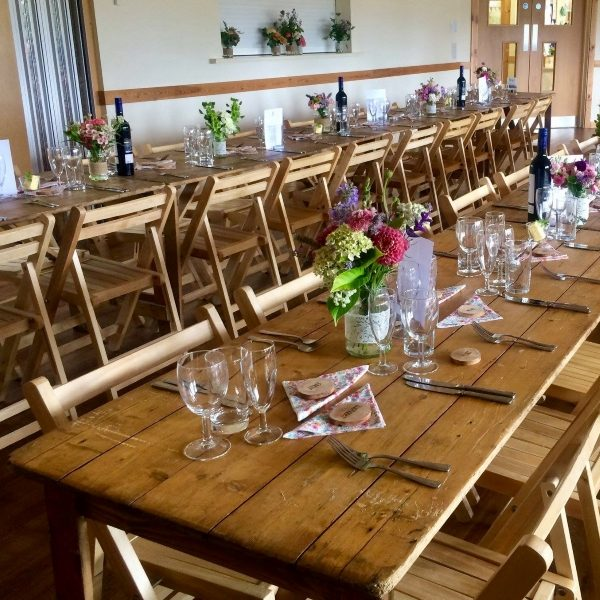 Rustic 6ft x 2ft 3inch trestle table with wooden folding chairs