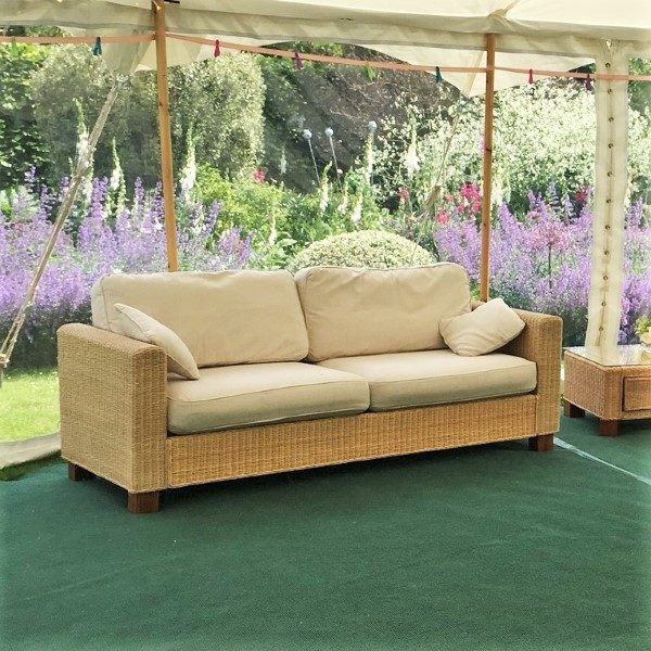 Beige rattan 3 seater sofas with ivory cushions