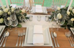 Square white crockery with Verdi cutlery, Reserva glassware and rustic furniture