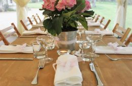 Coupe glasses on a rustic table with Verdi cutlery and white table linen