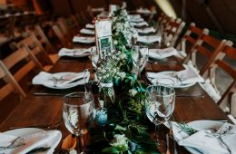 Rustic wedding setting with foliage runners and Savoie glassware