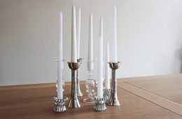 A range of silver and glass candlesticks